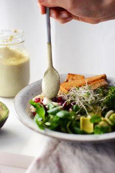 // nourish bowl. tofu, brown rice, vegetables & pumpkin seed sauce.