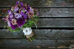 A beautiful #purple #Wedding #bouquet for one of our own! Love the burlap handle with lace detailing. By @Academy Florist