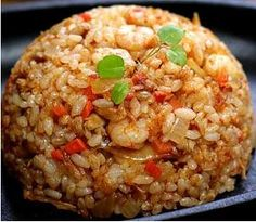 Korean kimchi fried rice. Ingredients: cooked rice, kimchi, minced pork or ground beef, green onion, soy sauce, onion, garlic, egg, olive oil, salt, pepper. Recipe from Tri Food.