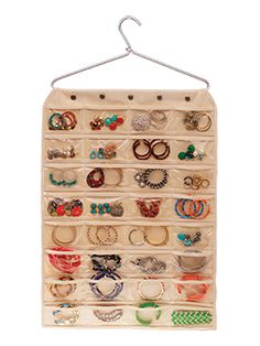 "Jewelry organizing made easy! No need to dig through drawers and boxes, now all of your jewelry can be placed in its own pocket. Vinyl compartments make everything easy to see and your wardrobe accessorizing more of a breeze. This double sided canvas organizer can hang on any sturdy closet hanger. Hanger and jewelry not included. Features 80 vinyl pockets. Canvas & vinyl. 34"" H x 18"" W."