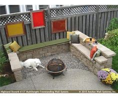 Seating area featuring the Highland Stone Wall System Outside Benches, Outside Patio, Outside Living, Outdoor Living, Outdoor Decor, Retaining Wall Design, Stone Retaining Wall, Wall Seating, Built In Seating