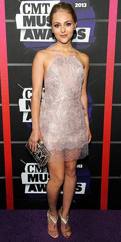 ANNASOPHIA ROBB The Carrie Diaries star fits in with the country crowd thanks to her sparkly lace Georges Chakra Couture halter and those crystal-encrusted B Brian Atwood heels.