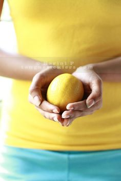 My daughter's cupping meyer lemon in her palms