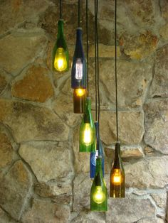 Seven Light with a Recycled Barnwood Mount  This Chandelier is made from seven wine bottles that are two different shapes a variety of colors. They are hanging from a 12 by 12 recycled barnwood ceiling mount. All of our wood is local sustainable wood. Choose your wood, walnut, oak, wormy maple, birch, let us know. The cords, sockets and ceiling mounts are black, but they can be white if want. The light hangs down 5, if you need it to hang a different length just let me know.  Dont have an…