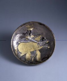 Sassanian Silver Gilt Plate with a Royal Prince Holding a Mare 4th-5th cent.