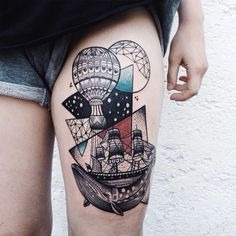 Vintage style colored thigh tattoo of whale with ship and balloon