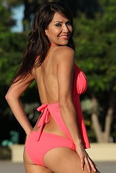 We love this coral open back tankini swimsuit with a halter neckline, the gorgeous apron back tankini style is trendy and fashion forward. The matching cheeky coral bikini bottoms top off this beach ready look! Available in regular and plus sizes at Sunnyside Swimwear!