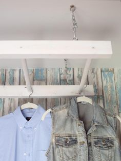 White Clothes Drying Rack Hanging From Ceiling in Laundry Room