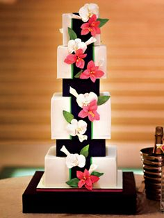 A Modern Pink-and-Navy Wedding Cake    It looked more like modern art than dessert, but we swear it was edible! Sugar paste lilies and orchids covered the fondant cake, which was displayed at the top of a staircase so everyone could admire it from their tables.  (From Caroline and Matt's traditional wedding in Savannah, GA)