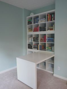 Semi-Built In Bookshelf - 2X4 IKEA Expedit bookshelves stacked on top if each other with Expedit desk -- ModernDayJibarita
