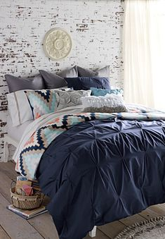 Features:  -Includes comforter cover and 2 matching shams.  -Button duvet and envelope sham.  -Pin-tucked solid color.  -Interior colors on the duvet cover: coral,white,navy blue,gray, light brown and