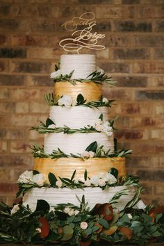 stunning gold/white cake with olive leaf