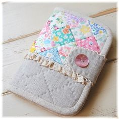 little floral patch - linen - lace and hand quilt...this is for a passbook but I would make it a sewing travel pouch