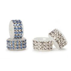 Michaels.com Wedding Department: David Tutera™ Shoe Heel Rings Add a dash of sparkle to the bride's wedding shoes. Circle of rhinestones fits over high heel. Includes two clear rhinestone and two blue rhinestone rings. Silicone inner construction to keep ring in place. Size: Interior of ring 1/2