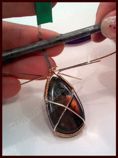 Check out http://labradoritesandgems.com!  How to wire wrap a stone or gem pendant. Step by step tutorial on wire wrapping.