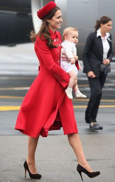 Kate wearing a Catherine Walker coat and Gina Foster hat at the Wellington Airport on 4/7/2014