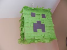 I made a Minecraft Creeper Head Pinata for my son's 6th Birthday Party. It cost about $5 to make and was very easy.