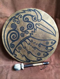 Deerskin raven drum with channelled design by Taz Thornton (www.firechild-shamanism.co.uk). Painted with woad-based acrylic.
