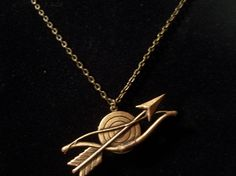 Katniss large bow and arrow with locket.  On sale at Etsy!!