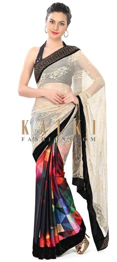Buy Online from the link below. We ship worldwide (Free Shipping over US$100) Price- $169 Click Anywhere to Tag http://www.kalkifashion.com/half-and-half-saree-enhanced-in-lace-and-geometric-print-only-on-kalki.html