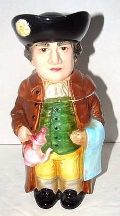Colonial Man  Beer Stein By A.A. Importing With Lid Holding Teapot & Tea towel