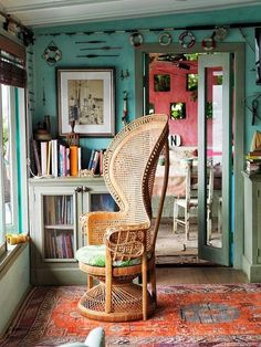 prettiest peacock chair and love the turquoise wall