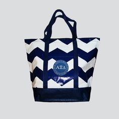 Chevron tote bag featuring an Alpha Xi Delta patch