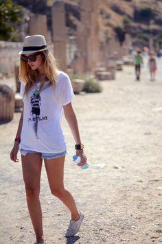 cute beach wear = jean shorts, long/loose shirt/light weight shirt and slip on shoes