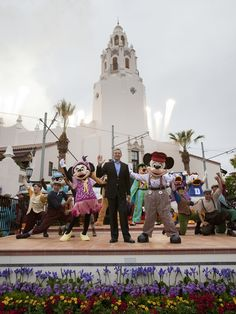 Walt Disney Co. Chairman and CEO Bob Iger and dozens of Disney characters and performers celebrate the Grand Reopening of Disney California Adventure park on June 15, 2012. The reopening showcases an expansion including two new lands, including the highly anticipated Cars Land. Mr. Iger and the Disney gang pose in front of the Carthay Circle Theater, the park's new central icon.
