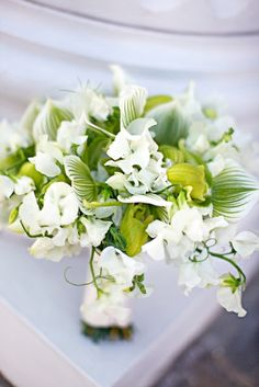White and Green Bouquet - Orchids - Sweet pea - garden style bouquet - Unique flowers - Flowers - Bridal Bouquet ideas - Inspiration - White and Green flowers - Orchids - Lady Slipper Orchids - Bride - Groom - Southern Wedding - Elegant - Classic Chic - Greens - Classy Lady - Traditional Ideas - Traditional wedding - Photography - Photo ideas - Flower shots - Wedding pictures - photographers - Knoxville Tn Florist - Wedding Florist Knoxville - Lisa Foster Floral Design - www.lisafosterdesign.com