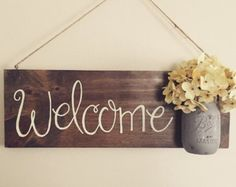 Welcome Sign, mason jar with flowers, home decor, front door sign, rustic home… Home Decor Signs, Diy Signs, Diy Home Decor, Welcome Door Signs, Front Door Signs, Front Doors, Mason Jar Crafts, Mason Jars, Mason Jar Flowers