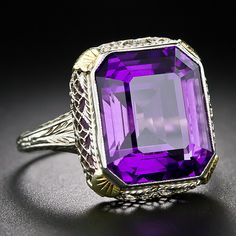 A rich, regal 9 Carat Emerald-Cut Amethyst is showcased to dramatic effect in this striking 1930s dinner ring. Fashioned in 14k white gold, ...