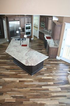 Multicolored hardwood floor   The Mommy Playbook   Idea Board for     Kitchens traditional kitchen  Wood FlooringHardwood