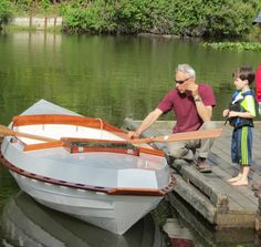 My friend Larry a boatbuilder in Warrenton, Oregon showing a young mariner my boat on its maiden voyage.