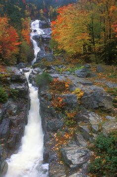 'Silver Cascade In Autumn' at Harts Location, New Hampshire, near Crawford Notch;  the cascade has an estimated 300 foot drop, with a series of cascades and plunges flowing down into the Saco River  - photo by John Burk