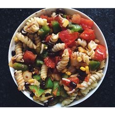 Carbo-loading with a southwestern pasta with black beans, corn, tomato, green pepper, onion, and mozz cheese. Flavored with cayenne pepper and black pepper to taste #dinner #homemade #healthy #columbusmarathon #columbus #cleaneating #foodie #foodstagram #eeeeeats #southwestern #spoonfeed #soulfuleating #Padgram