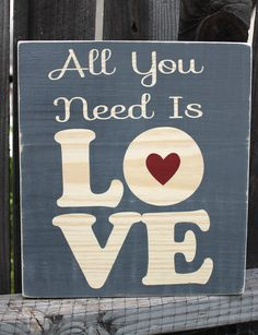"""All You Need is Love Hand Painted Wood Sign 11.5""""x10"""". $25.00, via Etsy."""