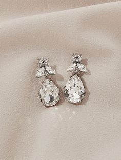 A classic and simple silhouette with a hint of floral elements. Wear them with tousled hair or a low bun for a sleek and luxurious vibe. Tousled Hair, Diamond Earrings, Silhouette, Luxury, Simple, Classic, Floral, How To Wear, Jewelry