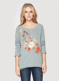 Celeste High/Low Sweatshirt The JWLA CELESTE HI/LO SWEATSHIRT is as comfortable as is it chic! With a stunning Oriental-inspired embroidery design that combines floral and bird motifs, this embroidered sweatshirt will fit seamlessly into your existing wardrobe!  - Cotton - Scoop Neck and Long Sleeves - Signature Embroidery - Machine Wash Cold, Tumble Dry Low
