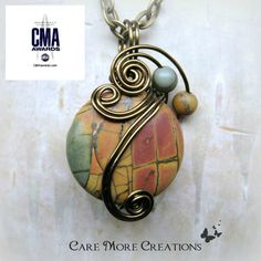Picasso Jasper Wire Wrapped Pendant As Gifted to CMA Award Celebrities by CareMoreCreations. Wire Pendant, Wire Wrapped Pendant, Wire Wrapped Jewelry, Ruby Pendant, Resin Jewelry, Jewelry Crafts, Jewlery, Jewelry Ideas, Wire Necklace