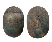 """Carved large light green limestone heart scarab. At the bottom, a cartouche.  Size: 3 ½"""" x 2 ½""""  Date: 1070-712 BC  Heart scarabs provided the bearer with the assurance that at the final judgment as depicted in the Book of the Dead, the bearer would be found """"True of Voice"""" and accepted into the eternal afterlife by the God Osiris."""