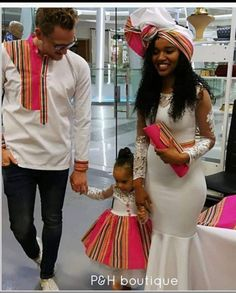 Image may contain: 2 people, people standing and text Couples African Outfits, African Dresses For Kids, African Print Dresses, African Attire, Venda Traditional Attire, Traditional African Clothing, Traditional Outfits, Tsonga Traditional Dresses, African Fashion Ankara