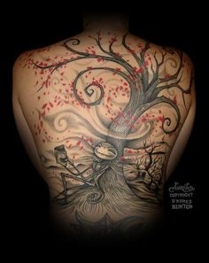 Jack Skellington and the legendary Tim Burton tree - full back tattoo. Awesome!