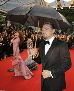Leonardo di Caprio - The actor was happy to protect himself from the wet weather as he made his way past other stars posing for pictures during proceedings