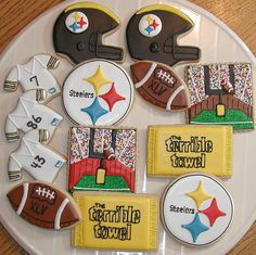 "My sister-in-law and I (DenyseAL here on Flickr) made this set of cookies for a Steeler's fan. We made a few extra for our families for Superbowl Sunday as well.  I first saw the idea of using nonpareils as the ""fans"" from Ali at Ali Bee's Bake Shop.  I asked her permission to use her idea as inspiration, and she graciously allowed me. Thank you so much, Ali!  Here are her amazing cookies:  www.flickr.com/photos/snargblog/5167729970/"