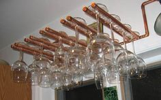copper pipe wine glass rack love love love....would make it tiered and smaller