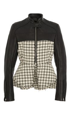 This **Alexander Wang** motorcycle jacket features a standing collar with leather sleeves and a plaid tweed bodice with an asymmetric peplum hem.