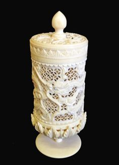 A Chinese Pierced Ivory Box Decorated With Dragons With A Circular Lid and a Carved Decorated Stand