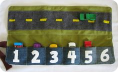 homemade by jill: cozy car caddy tutorial. Not only is it a great toy, but what a brilliant idea for storing all those loose match box cars!