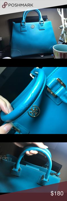 Tory burch Robinson shoulder bag Only use once and I just found that my cat bit the handle...you can see the bite mark in the pic  It is a chic blue handbag, perfect for working/dating...almost everything Top L : 10.5 inches Bot L: 13 inches H: 9 inches W: 5.5 inches Tory Burch Bags Shoulder Bags
